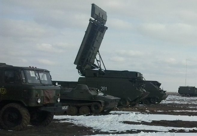 "The third vehicle from the left is a Snow Drift Radar that can be used as part of the Buk system. The number on the side reads ""201"". [Source]"