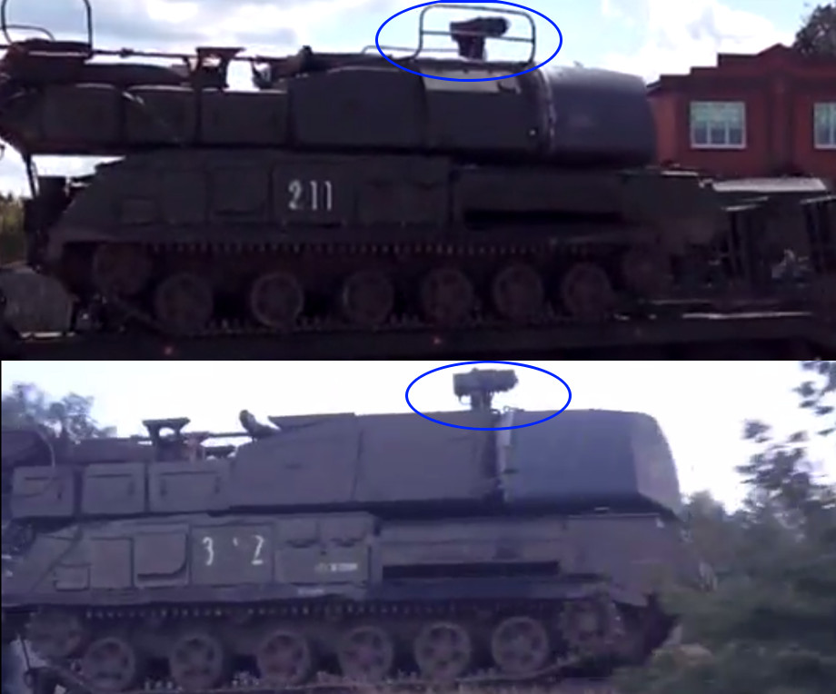 The top image is an example of a Buk with railings. [Source] Bottom image: the Buk with the markings outside of Staryy Oskol. [Source]
