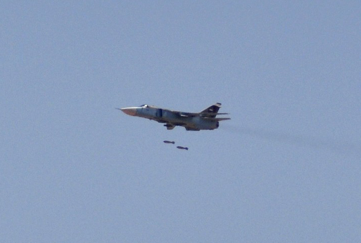 Undated handout photo shows a Syrian military aircraft taking part in a live ammunitions exercise in an undisclosed location