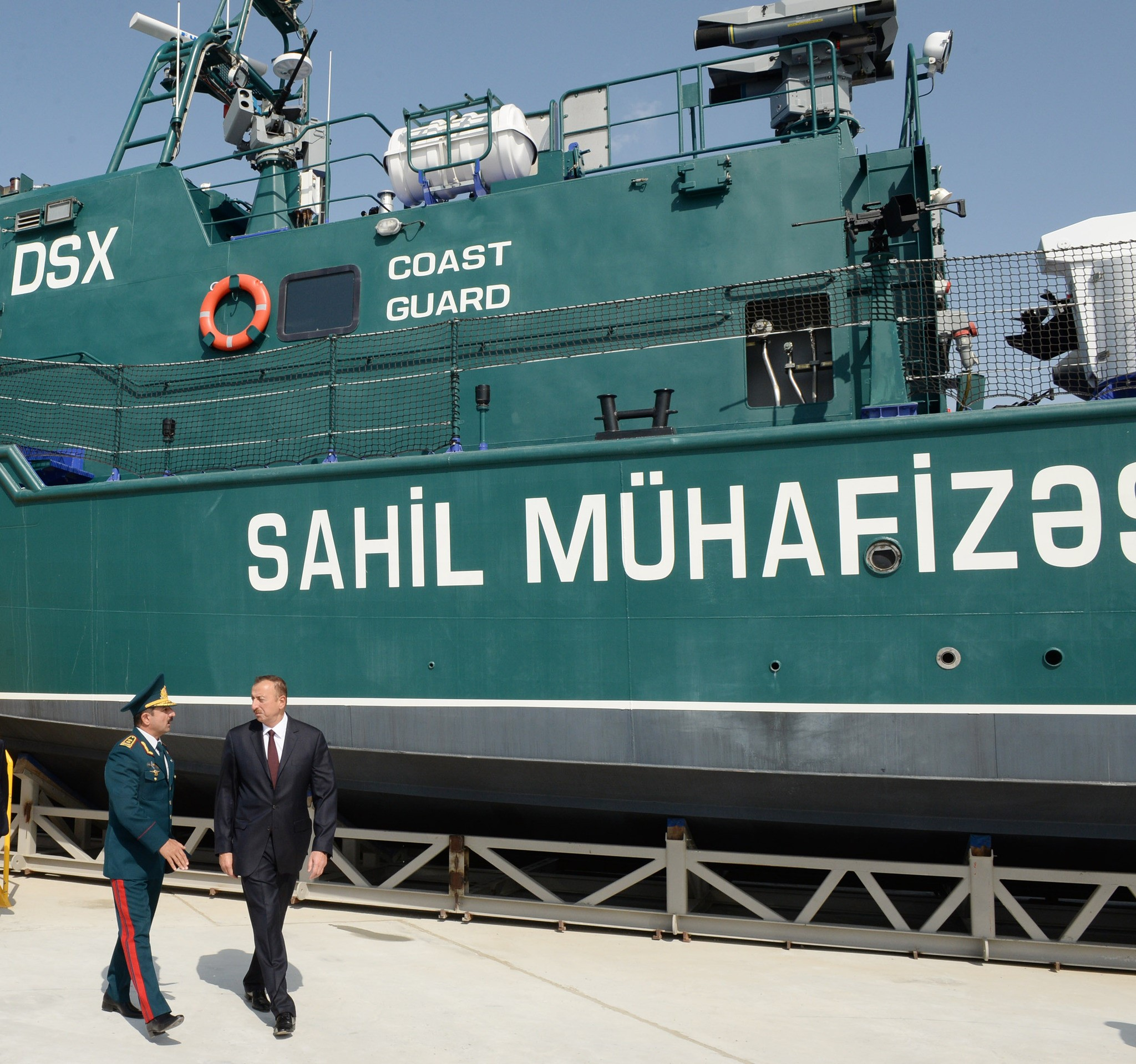 Picture President IIham Aliyev and the new revamped state boarder service coast guard ships at the ship building facility. Note ship on dry dock platform. (Spike missile top right centre).