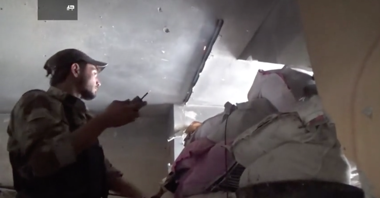 A fighter in Jaish al-Islam readies a small improvised grenade