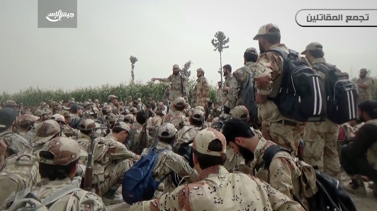 Jaish al-Islam fighters wearing standardized hats, uniforms and boots