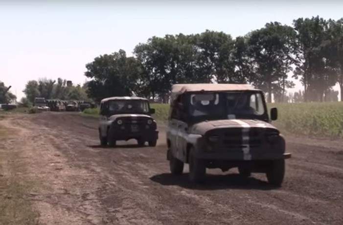 UAZ jeeps at the base, filmed on July 5, 2014