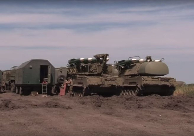 Buk missile loader (middle) and a Buk missile launcher (right)