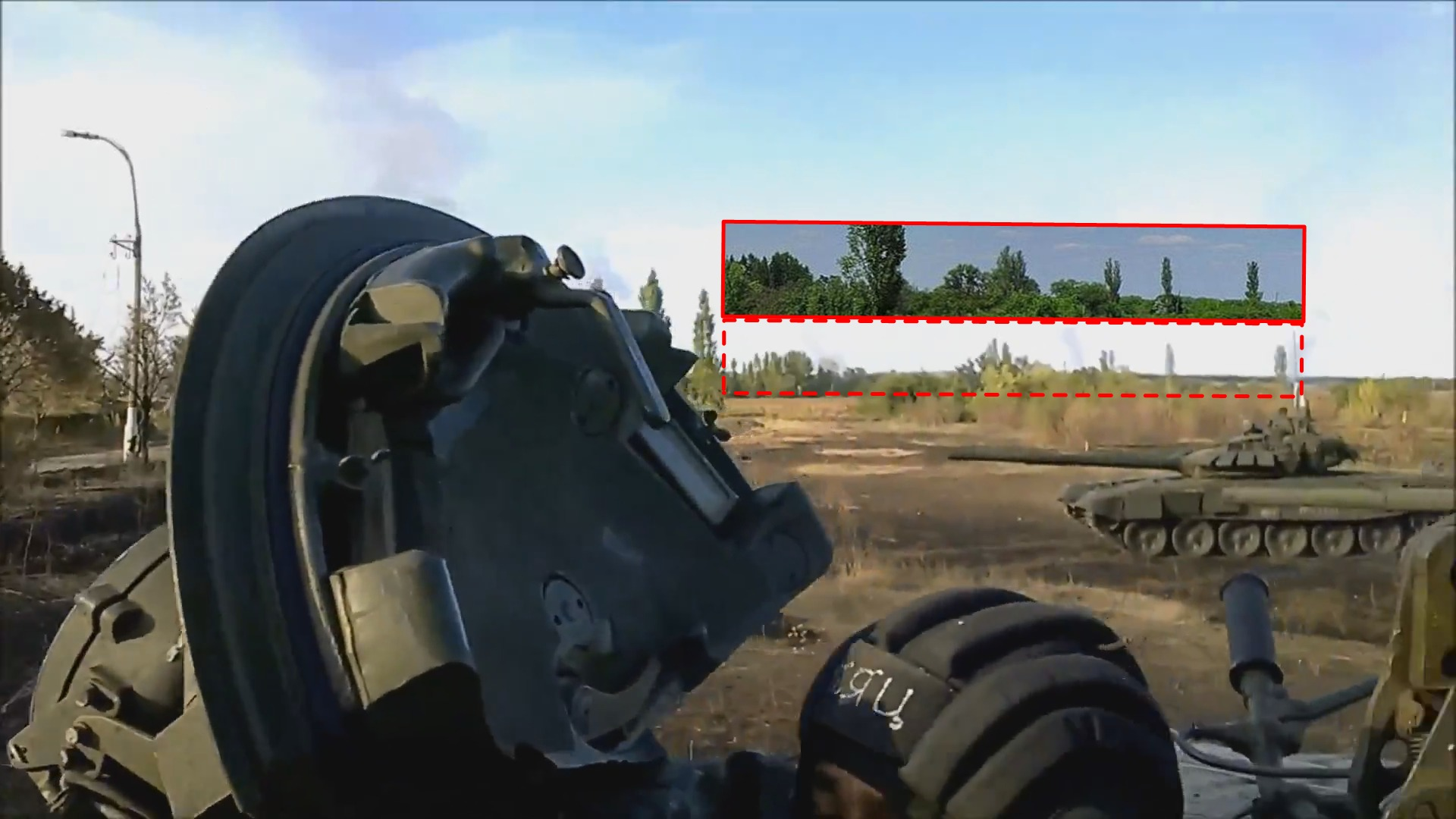 The same line of trees, visible in the video of the 200th Brigade at the Luhansk Airport, looking northeast