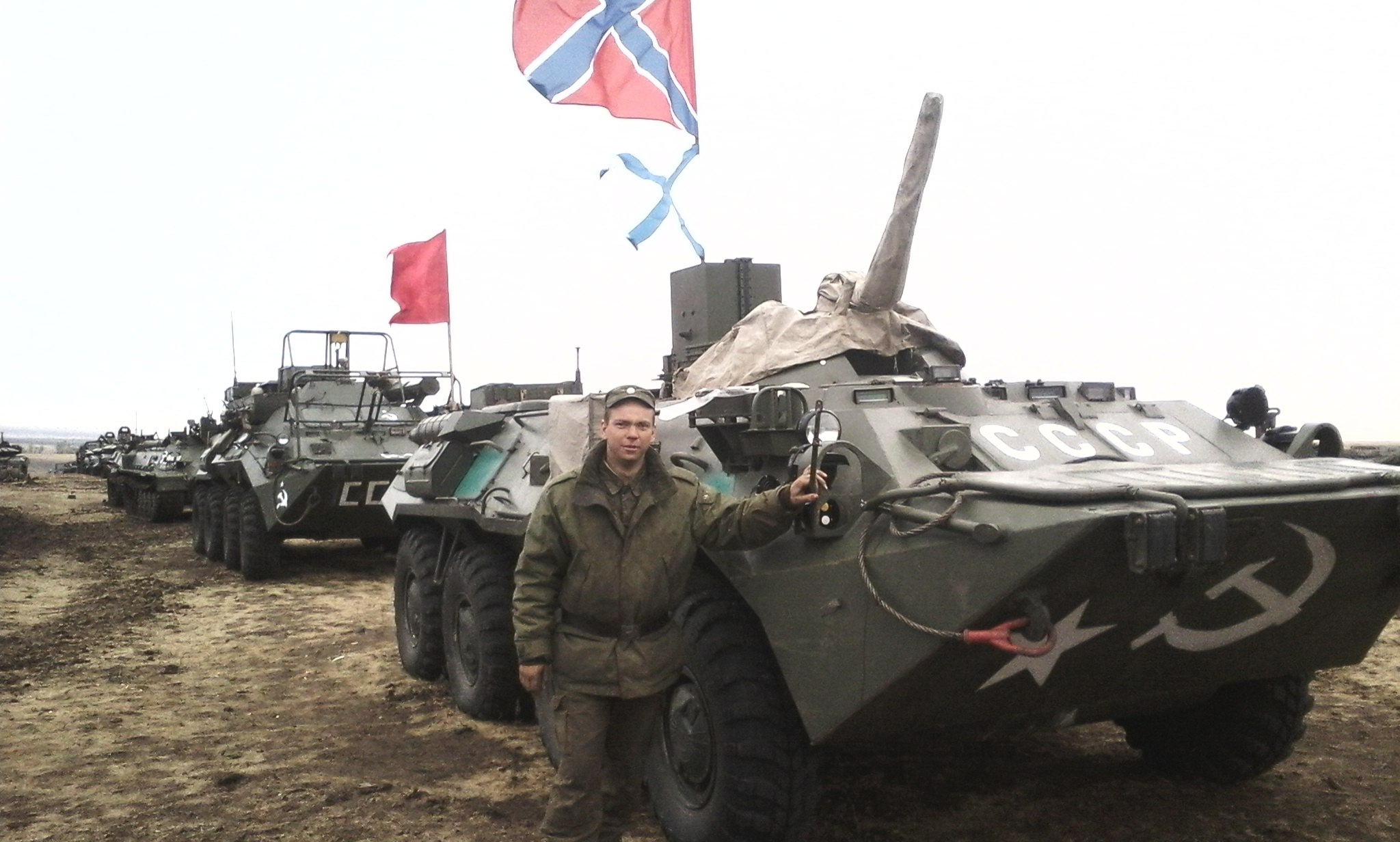 Photograph from the account of Nikolai Dugaev, showing military equipment with the Russian naval ensign and naval jack. This is not the same as the flag of Novorossiya.