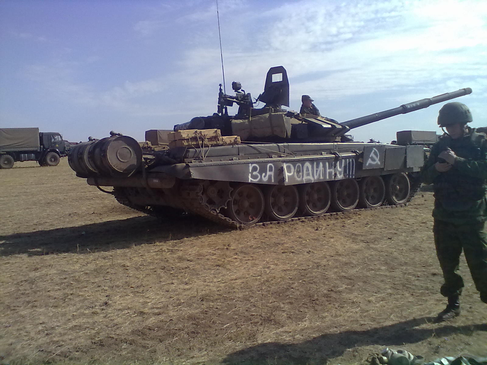 "T-72B3 tank with an unknown number (likely 824) and the inscription ""FOR THE MOTHERLAND!!!"" on the right side. Archive / Original"