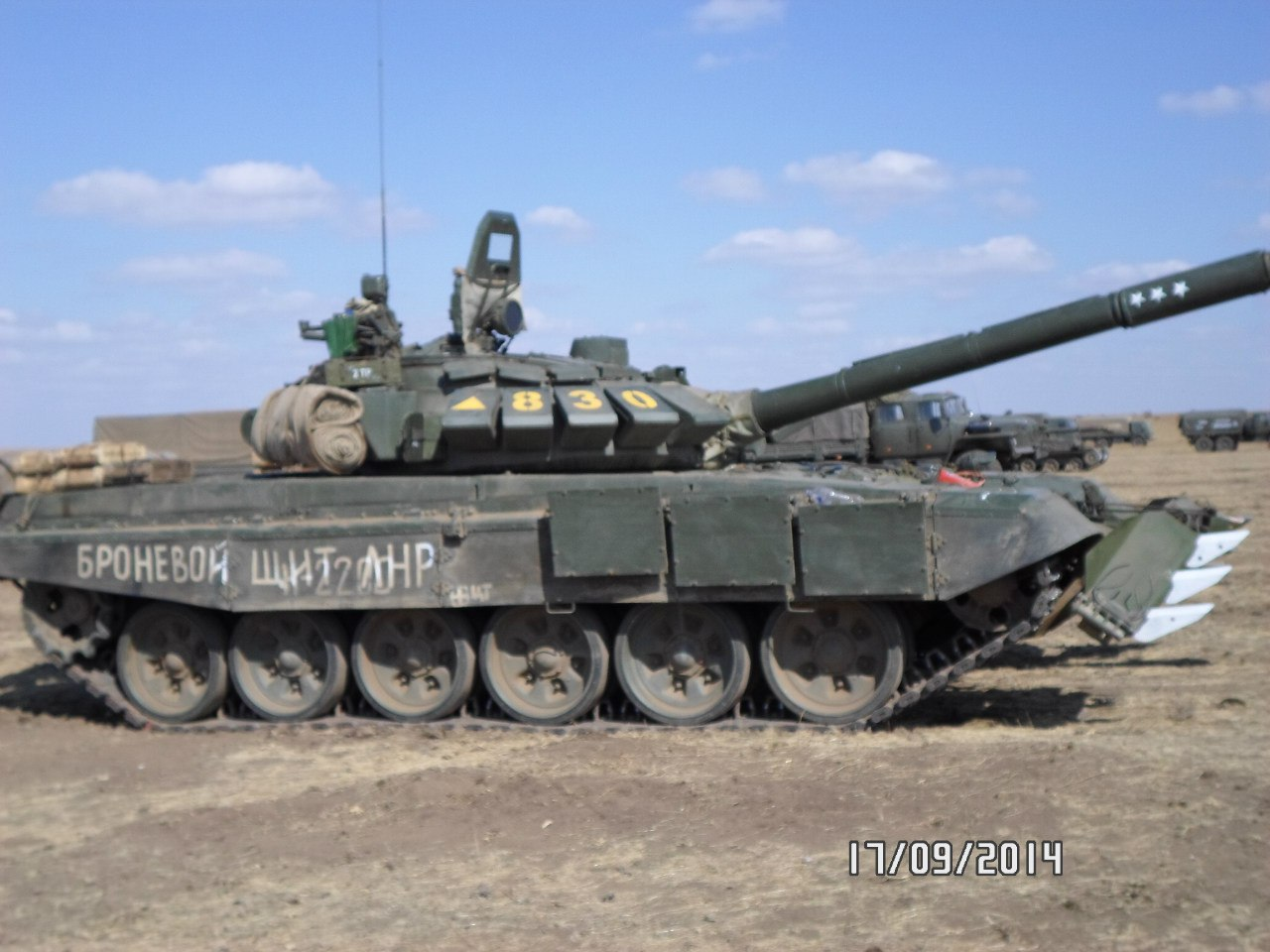 "T-72B3 tank numbered 830 with the inscription ""ARMORED SHIELD OF THE LNR"" on the right side. Archive / Original"
