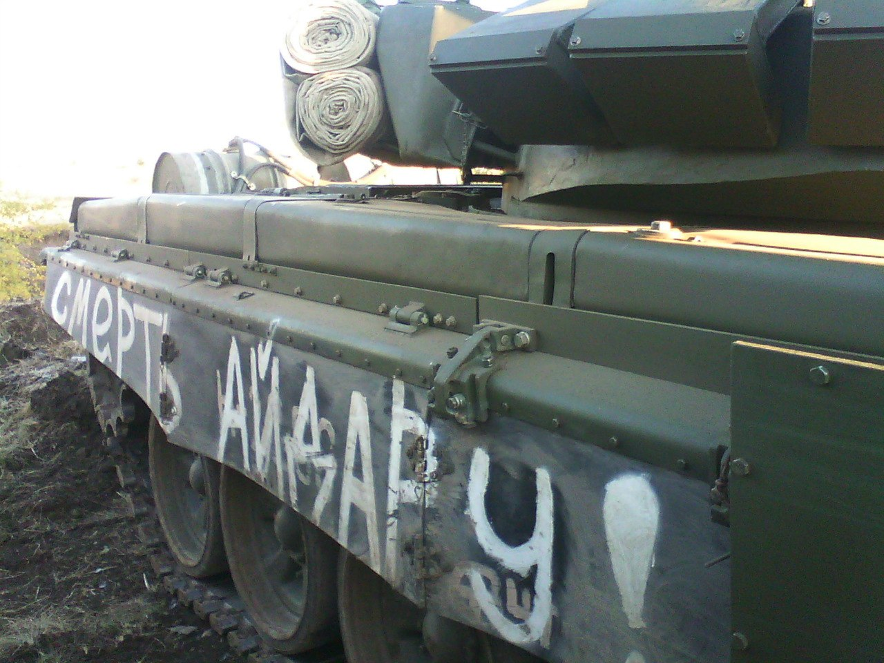 "T-72B3 tank without a number, with the inscription ""DEATH TO AIDAR"" on both sides. Archive / Original"