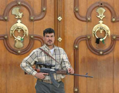 A combatant holding what appears to be a Tabuk sniper rifle