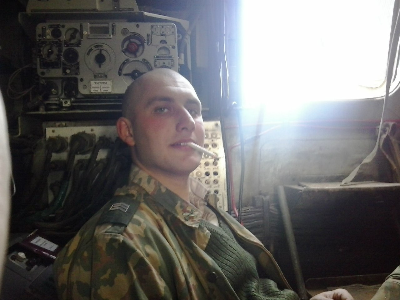 Krasnoproshin inside one of the unit's vehicles. The chevrons indicate that he is a sergeant. [Source]