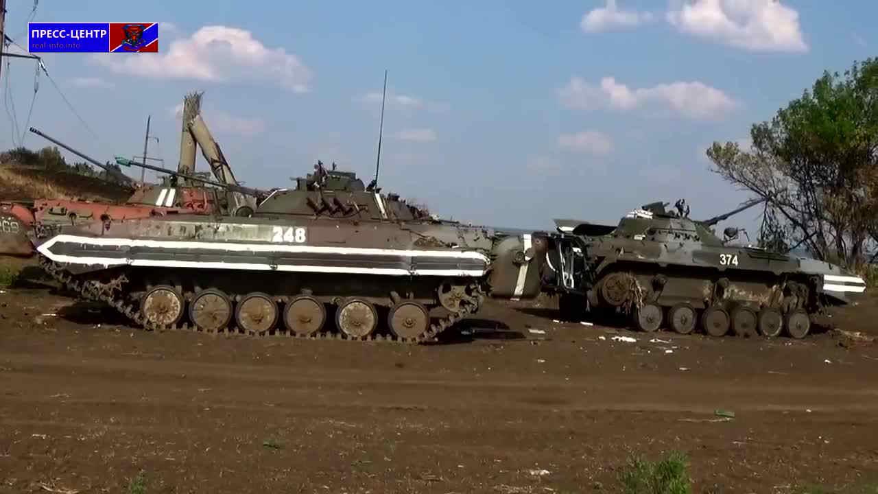 """A shot of four damaged Ukrainian vehicles from the video """"Уничтоженная военная техника под Свердловском 72 бригады ВСУ"""""""