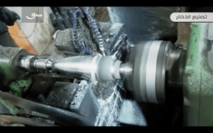 7. The mortar round is shaped on a lathe