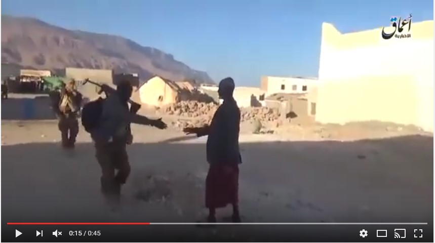 A remaining Qandala resident greets an ISIS fighter (Uploaded on Youtube via Radio Qandala)